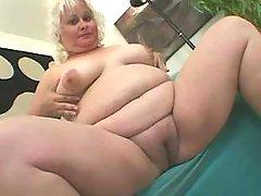 Fat blonde granny in red sucks cock