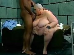 Bald big woman sucks in prison cell