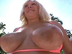 Busty blonde rides big cock on sofa