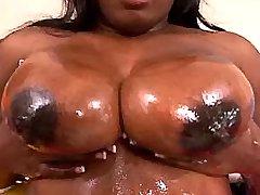 Chubby ebony cutie shows huge boobs