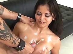 Exotic doll gets cumload on breasts