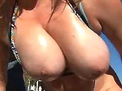 Two chesty sluts seduce guy outdoor