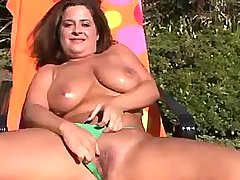 Girl shows her massive oiled melons