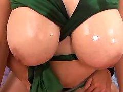 Guy caresses huge boobs of brunette