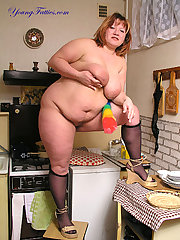 Naked plump posing on the kitchen