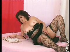 Older woman in stockings enjoying pussy